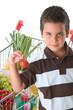 Little child holding tomato