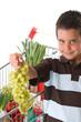 Little child holding grape