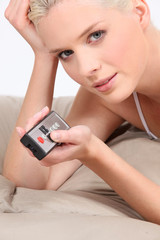 Closeup of a woman with a remote control