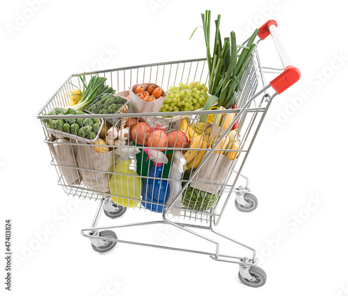Shopping cart full of grocery isolated on white background