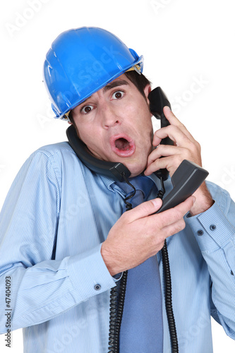 Stressed architect on the telephone