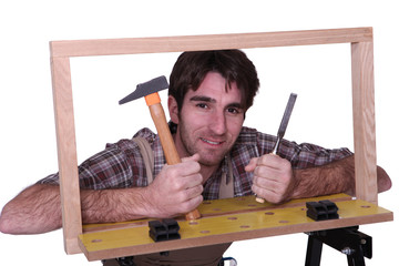 a carpenter posing with tools