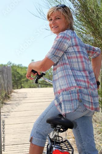 senior woman riding a bike