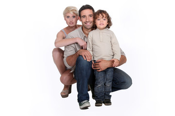 Young family posing in a studio
