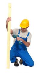 A male carpenter with a drill.