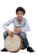 Boy playing a djembe