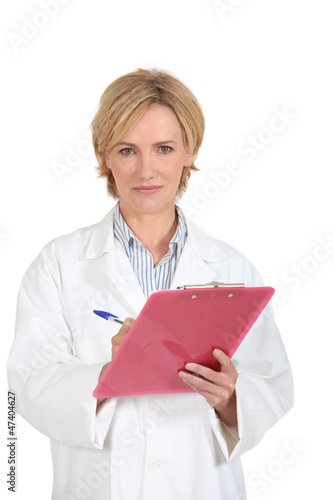 woman doctor taking notes