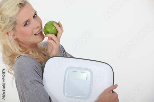 Woman with apple and scales