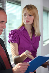 Businesswoman explaining document to colleague