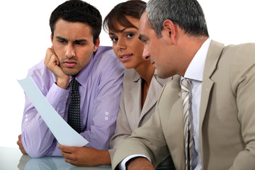 Three professionals in meeting