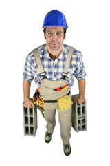 Builder carrying blocks