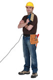 Man with an electric sander