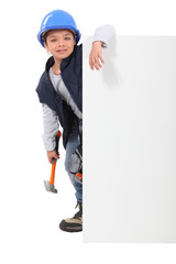 Child builder with a board left blank for your message