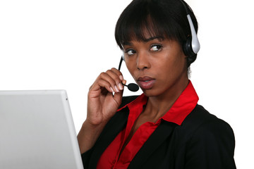 Afro-American businesswoman with headset on her head
