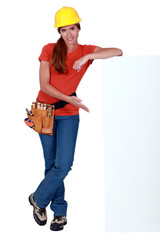 craftswoman presenting a blank ad board