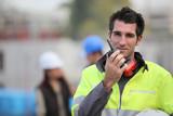 Traffic guard speaking into his walkie talkie poster