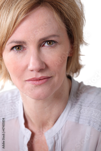 Woman with neutral expression.