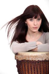 Attractive brunette with bongo