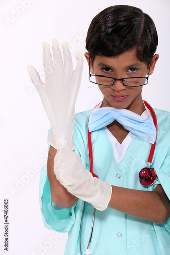 Boy dressed as a hospital surgeon