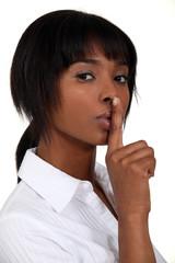 Woman making shush gesture