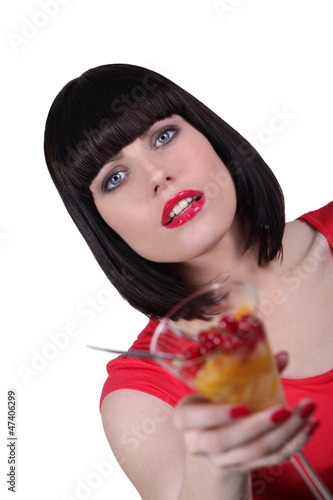 woman with cup of fruits