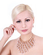 beautiful young woman with pearl necklace and earrings on white
