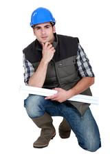 A pensive tradesman