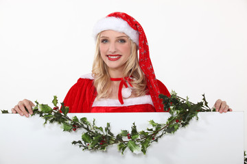 Miss Santa with a board left blank for your message
