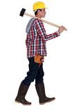 Man carrying sledge-hammer
