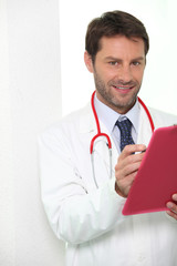 Young doctor with binder