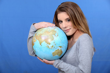 Woman hugging globe