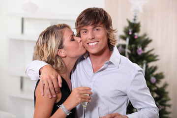 Couple kissing at Christmas