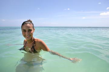 Happy woman having a bath in the sea