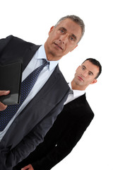 two businessmen, studio shot