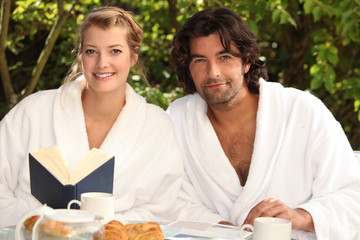 Couple having breakfast in the garden