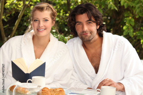 Couple having breakfast in the garden