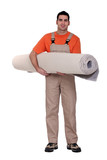 Carpet fitter carrying a roll of carpet poster