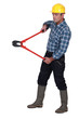 Labourer holding large clippers