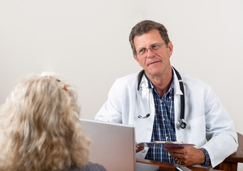 Doctor Listening to Female Patient in Office