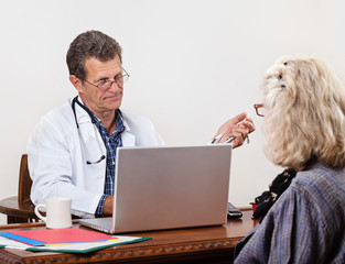 Unsympathetic Doctor Listening to Female Patient in Office