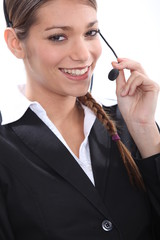Smiling female telemarketer