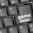 Computer keyboard with game over key - technology background