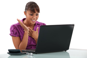 Happy woman at the computer