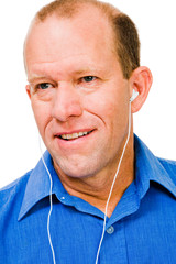 Close-up of a man listening music
