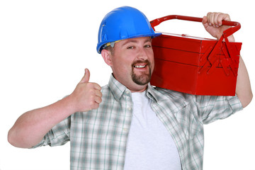 Tradesman carrying a toolbox and giving the thumb's up