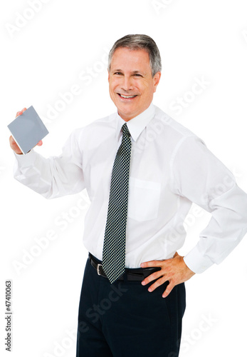 Happy businessman holding placard