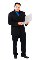 Latin American businessman using laptop