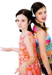 Two girls listening music on headphones