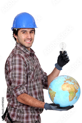 electrician holding globe and light bulb