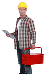 Builder holding clip-board and tool box